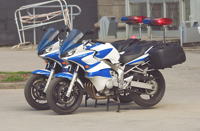 two police motorcycles are staying on the street